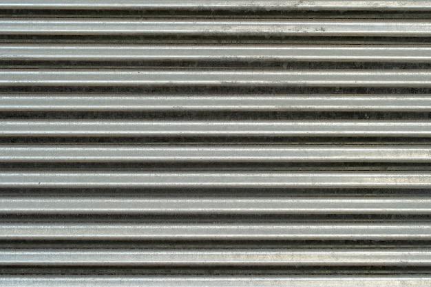 Texture de mur en métal, arrière-plan. tôle de métal galvanisé nervuré pour structures de bâtiment