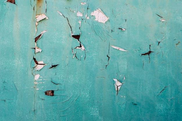 Texture de mur peint fissuré bleu