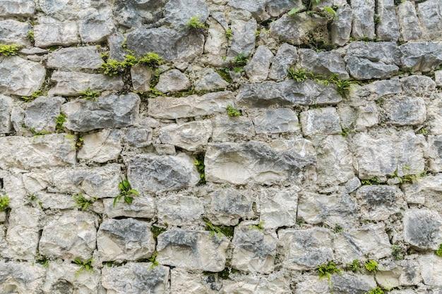 Texture de mur de pierre grungy vieux