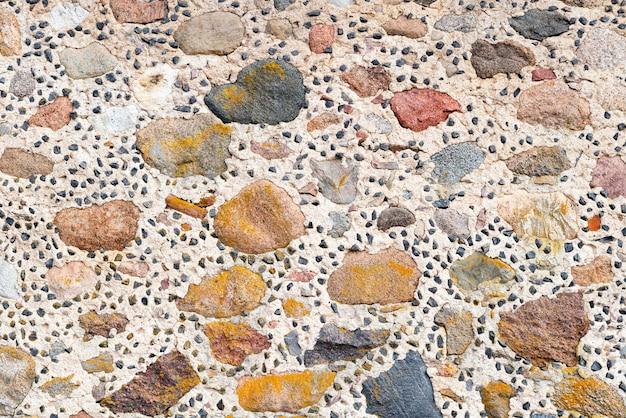 Texture de mur en pierre à la main.