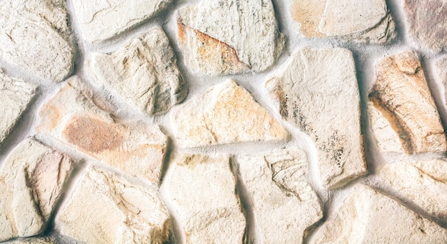 Texture de mur de pierres naturelles décoratives. fond abstrait en béton.