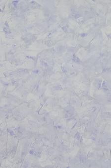 Texture de mur de plâtre bleu vieux patiné et teinté