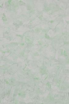 Texture de mur en plâtre vert vieilli et teinté