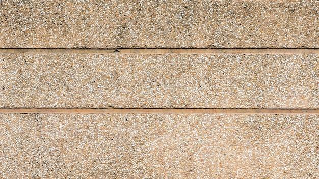 Texture de mur de sable se bouchent