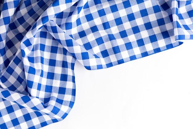 Texture de nappe bleue sur fond blanc
