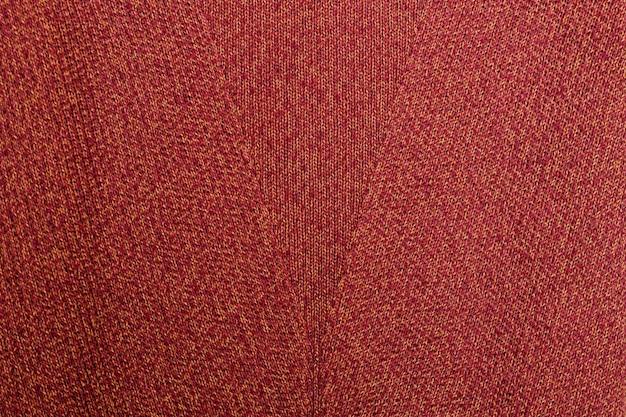 Texture orange rouge. tissu tricoté avec motif