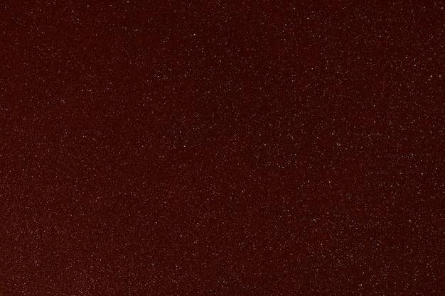 Texture pailletée rouge foncé