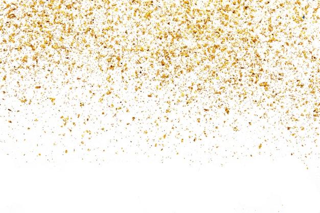 Texture de paillettes dorées sur mur abstrait blanc