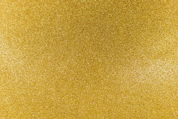 Texture de paillettes d'or brillant doré abstrait de noël.