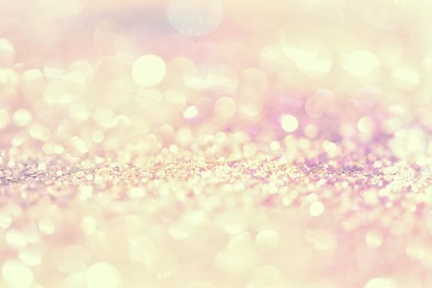 Texture de paillettes d'or coloré abstrait flou coloré pour la veille du nouvel an anniversaire
