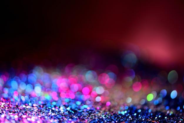 Texture de paillettes d'or coloré abstrait flou pour anniversaire du nouvel an ou noël