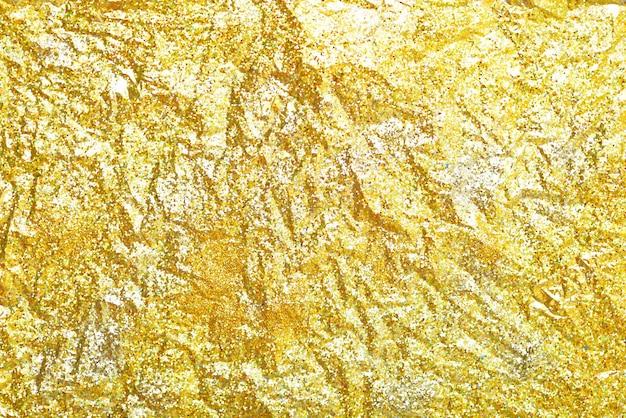 Texture de paillettes d'or coloré abstrait flou pour l'anniversaire du nouvel an ou