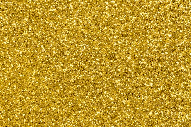 Texture de paillettes d'or, lumières scintillantes de vacances