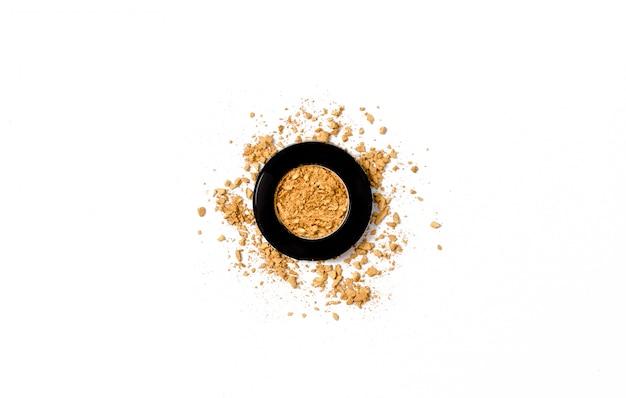 Texture de palette de fard à paupières doré écrasé.