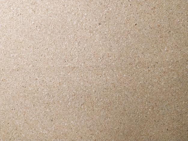 Texture de panneau de particules de couleur de fond brun close up