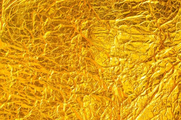 Texture de papier en aluminium de béton d'or