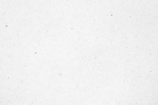 Texture de papier blanc ou de carton avec fond de tache noire.