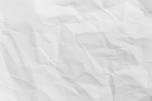 Texture de papier blanc froissé recyclé ou fond de papier