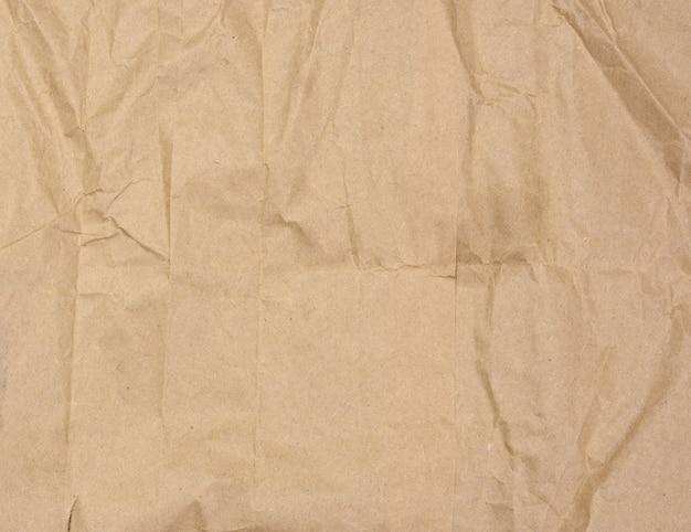 Texture de papier brun froissé, plein cadre