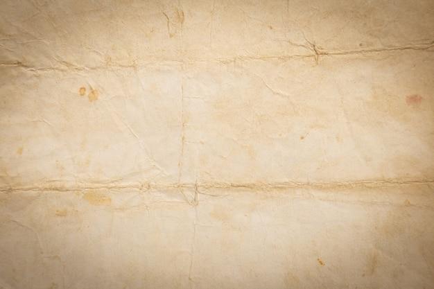 Texture de papier brun froissé recyclé ou papier