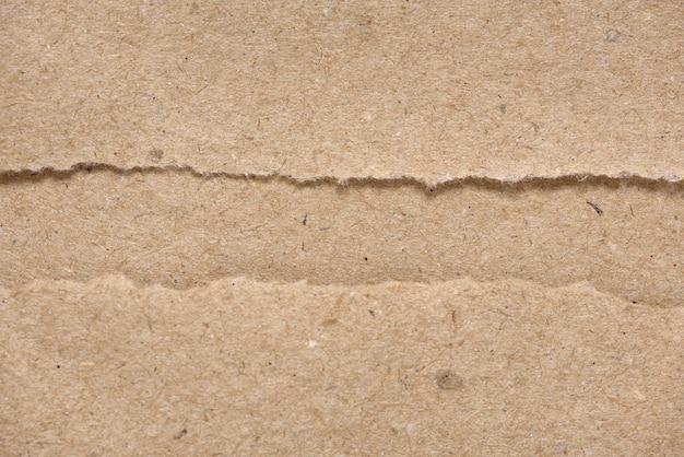 Texture de papier déchiré artisanal brun
