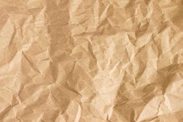 Texture de papier doré froissé. papier froissé brun