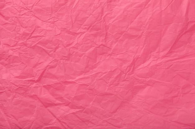 Texture de papier d'emballage rose froissé