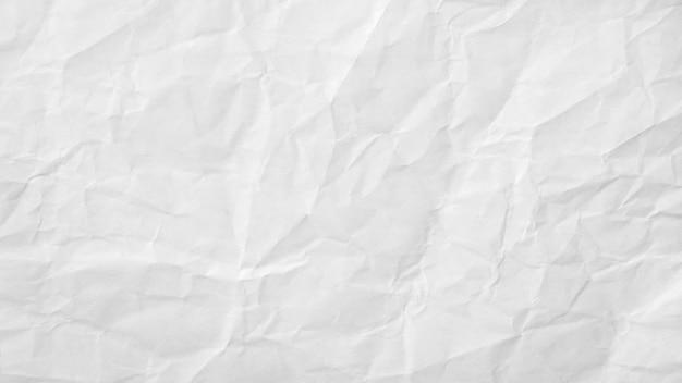 Texture de papier froissé blanc pour la conception et le texte