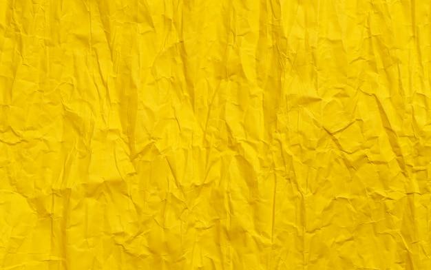 Texture de papier froissé jaune, couleur grunge
