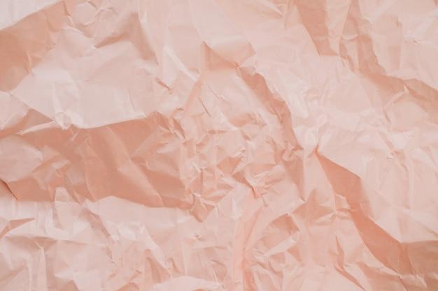 Texture de papier froissé pêche colorée