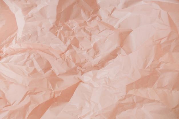 Texture de papier froissé pêche pastel
