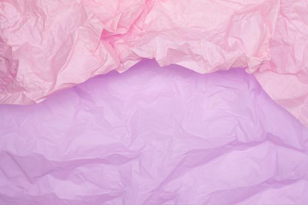 Texture de papier froissé rose bicolore, fond rose, papier peint