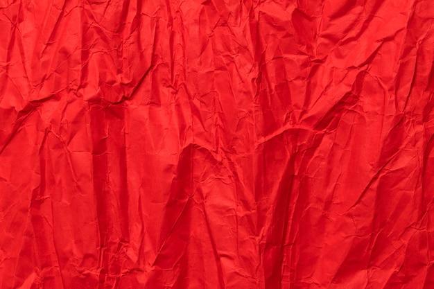 Texture de papier froissé rouge, fond grunge