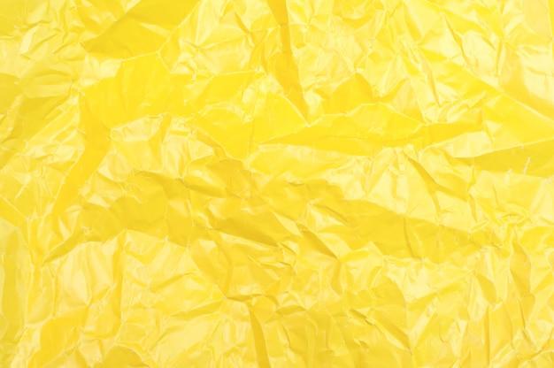 Texture de papier jaune froissé. fond jaune