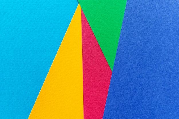 Texture papier jaune, rouge, vert et bleu.