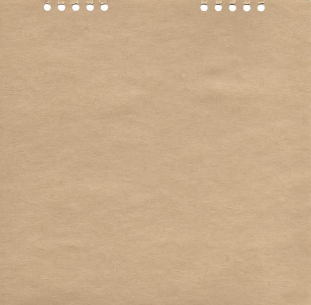 Texture de papier kraft avec des trous abstrait naturel brun illustration de surface rugueuse vierge