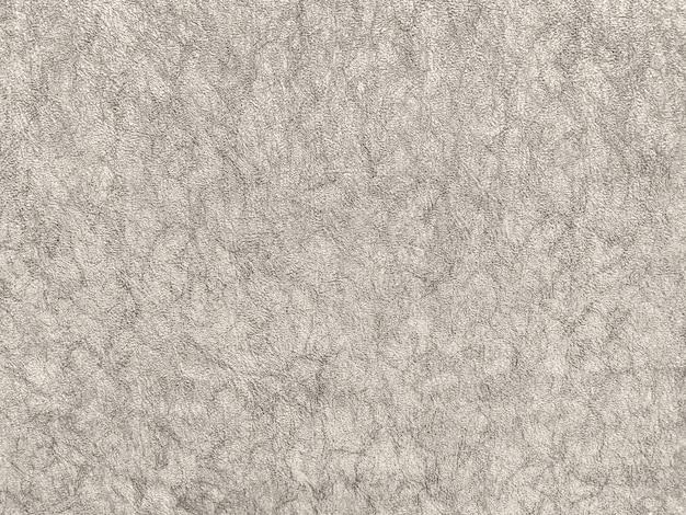 Texture de papier peint beige avec un motif
