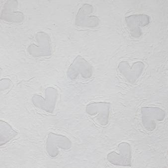 Texture de papier peint avec des formes de coeur