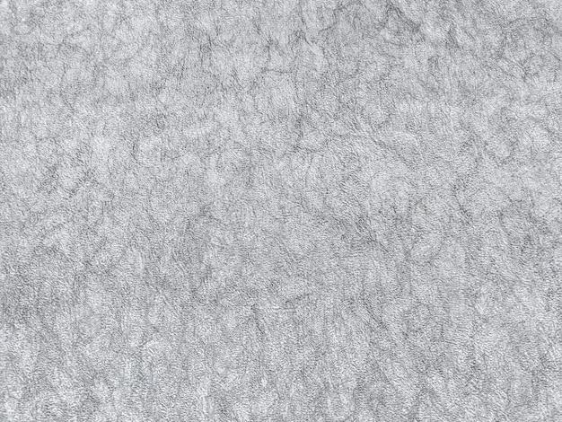 Texture de papier peint gris avec un motif