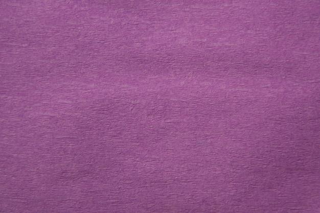 Texture de papier violet ondulé pour le fond