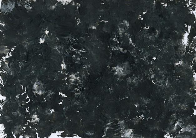 Texture de peinture acrylique liquide abstraite dessinée à la main dans des couleurs noir et blanc. fond peint avec effet marbré. art contemporain moderne