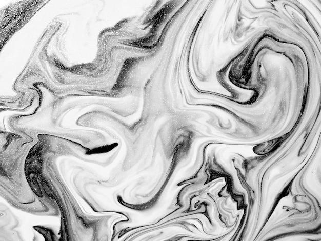 Texture de peinture acrylique noir et blanc avec des formes organiques abstraites