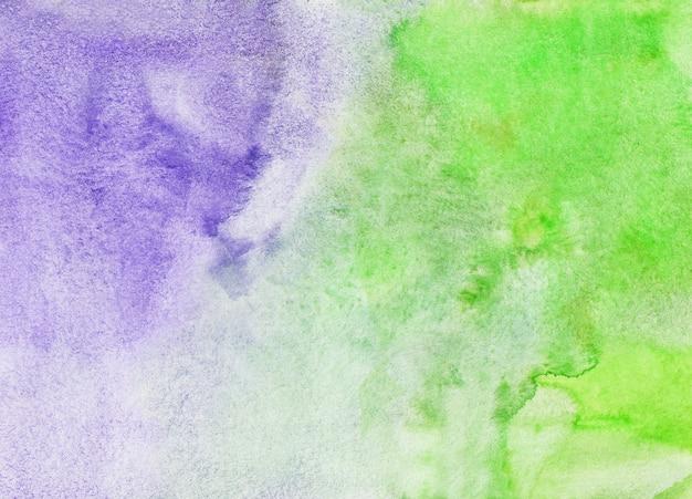Texture de peinture aquarelle fond vert clair et violet