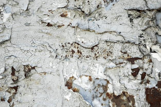 La texture de la peinture écaillée sur le métal