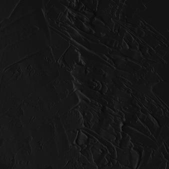 Texture de peinture à l'huile abstraite noire sur toile ou mur.