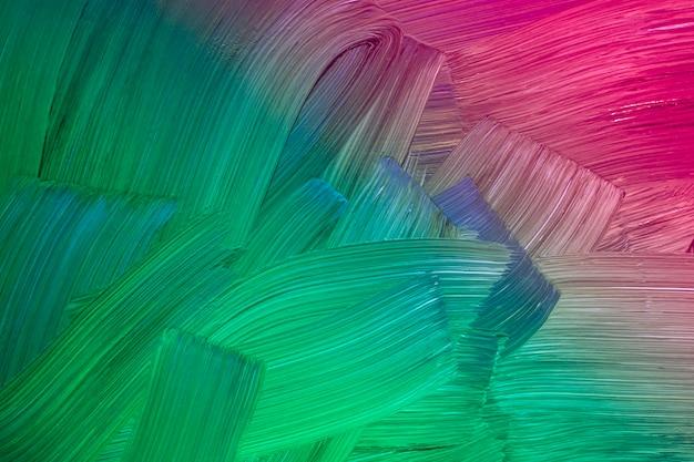 La texture de la peinture à l'huile sur toile aux couleurs néon. fond d'art abstrait. coups de pinceau rugueux de peinture. peut être utilisé comme arrière-plan.