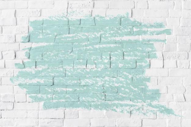 Texture de peinture à l'huile vert menthe sur un mur de briques blanches