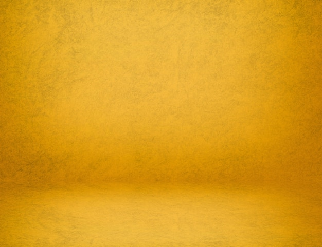 Texture de peinture de loft de ciment de mur jaune abstrait studio utiliser comme toile de fond