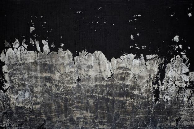 Texture de la peinture noire ancienne décollant fond de mur en béton