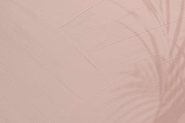 Texture de peinture rose terne avec ombre de feuille